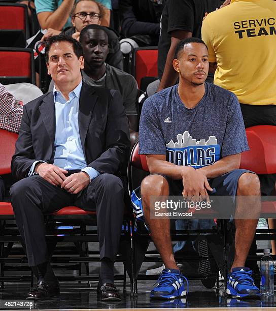 Mark Cuban owner and Devin Harris of the Dallas Mavericks sit on the bench before a Las Vegas Summer League game on July 11 2015 at the Cox Pavilion...