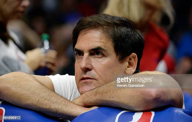 Mark Cuban owner of the Dallas Mavericks follows the action from behind the bench during the third quarter of the basketball game against Los Angeles...