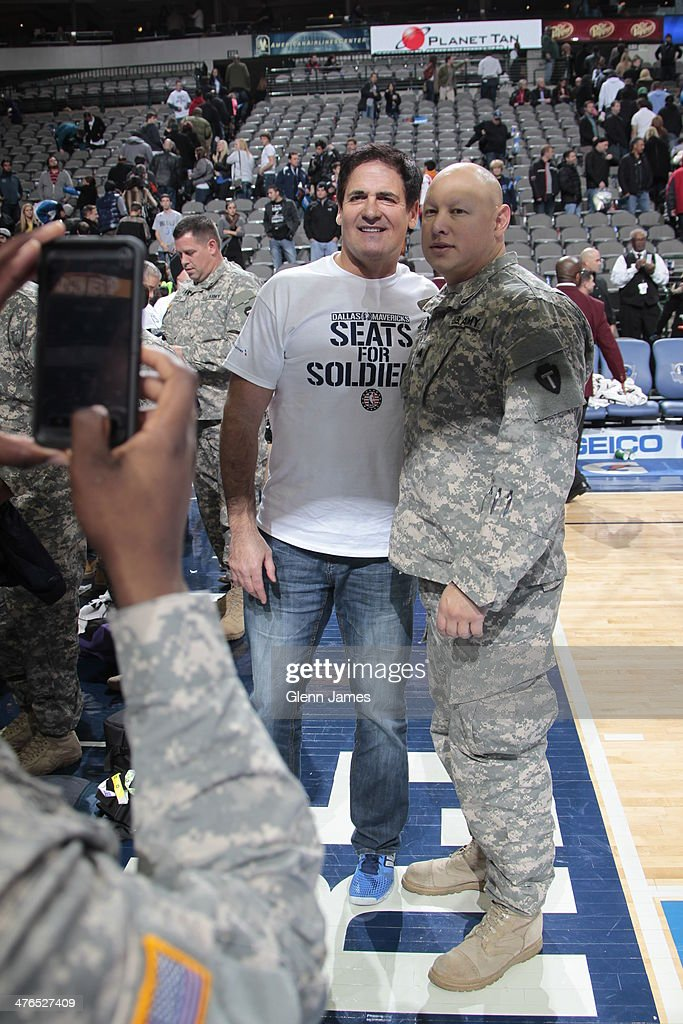 <a gi-track='captionPersonalityLinkClicked' href=/galleries/search?phrase=Mark+Cuban&family=editorial&specificpeople=203295 ng-click='$event.stopPropagation()'>Mark Cuban</a> poses for pictures before the Dallas Mavericks play against the Milwaukee Bucks on December 14, 2013 at the American Airlines Center in Dallas, Texas.
