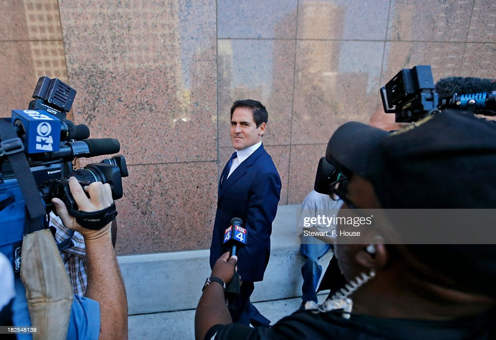 <a gi-track='captionPersonalityLinkClicked' href=/galleries/search?phrase=Mark+Cuban&family=editorial&specificpeople=203295 ng-click='$event.stopPropagation()'>Mark Cuban</a> speaks with the media after leaving the Earle Cabell Federal Building and Courthouse in downtown Dallas on September 30, 2013. Cuban was expected to testify in the government's insider-trading case against him.