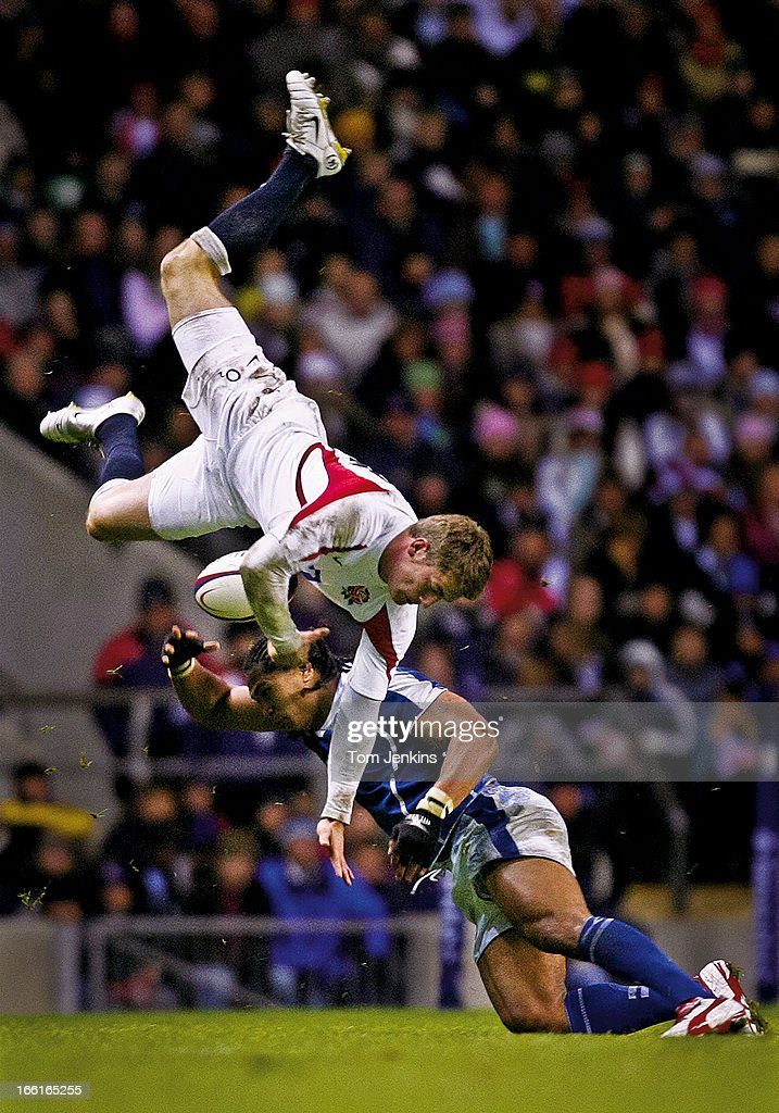 Mark Cueto of England (top) is upended by Alesana Tuilagi of Samoa during the England v Samoa international rugby union match at Twickenham Stadium on November 26th 2005 in Twickenham, London (Photo by Tom Jenkins/Getty Images). An image from the book 'In The Moment' published June 2012