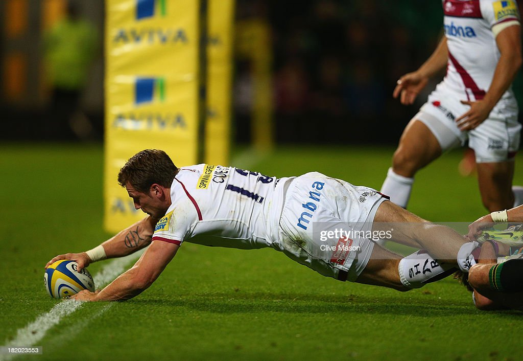 Mark Cueto of Sale Sharks scores a try during the Aviva Premiership match between Northampton Saints and Sale Sharks at Franklin's Gardens on September 27, 2013 in Northampton, England.