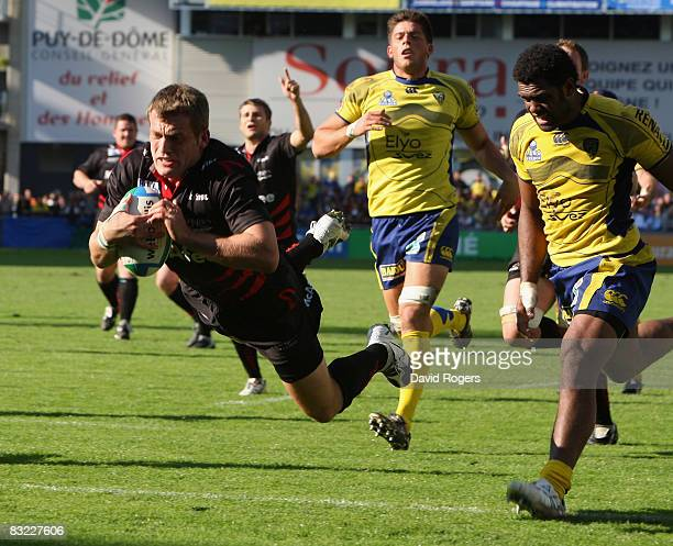 Mark Cueto the Sale wing dives over to score the fourth try during the Heineken Cup match between ASM Clermont Auvergne v Sale Sharks at Stade Marcel...