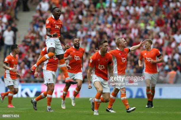 Mark Cullen of Blackpool celebrates as he scores their second goal with team mates during the Sky Bet League Two Playoff Final between Blackpool and...