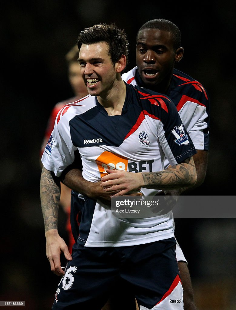 Mark Davies of Bolton Wanderers celebrates scoring the opening goal with team mate Fabrice Muamba (R) during the Barclays Premier League match between Bolton Wanderers and Liverpool at the Reebok Stadium on January 21, 2012 in Bolton, England.