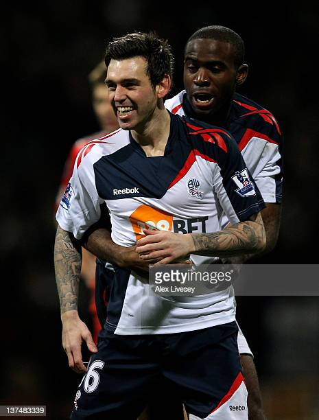 Mark Davies of Bolton Wanderers celebrates scoring the opening goal with team mate Fabrice Muamba during the Barclays Premier League match between...