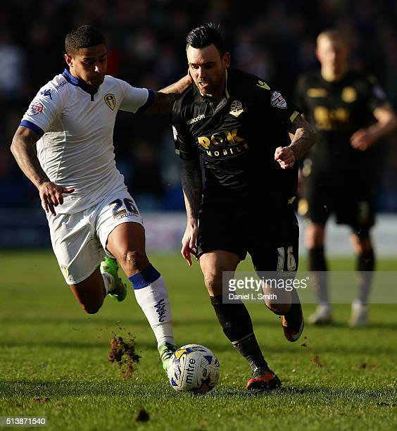 Mark Davies of Bolton Wanderers FC under pressure from Charlie Taylor of Leeds United FC during the Sky Bet Championship League match between Leeds...