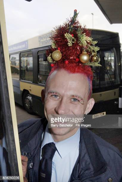 Mark Davis from Pontypool a South Wales bus driver who has spruced himself up for Christmas by having a mini fir tree woven into his hair Wednesday 7...