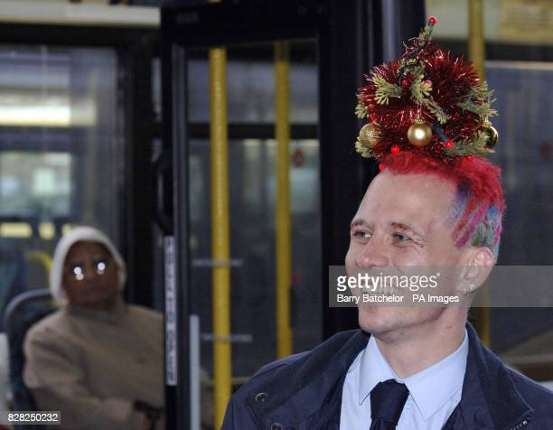 Mark Davis from Pontypool a South Wales bus driver who has spruced himself up for Christmas by having a mini fir tree woven into his hair