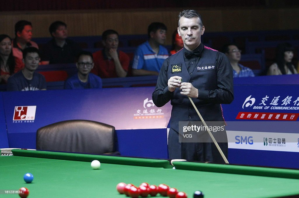 Mark Davis of England eyes the ball in the match against John Higgins of Scotland on day four of the 2013 World Snooker Shanghai Master at Shanghai Grand Stage on September 19, 2013 in Shanghai, China.