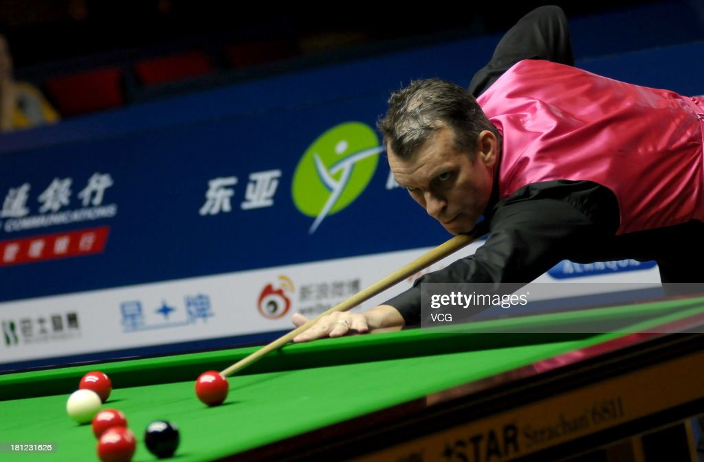 Mark Davis of England plays a shot in the match against John Higgins of Scotland on day four of the 2013 World Snooker Shanghai Master at Shanghai Grand Stage on September 19, 2013 in Shanghai, China.
