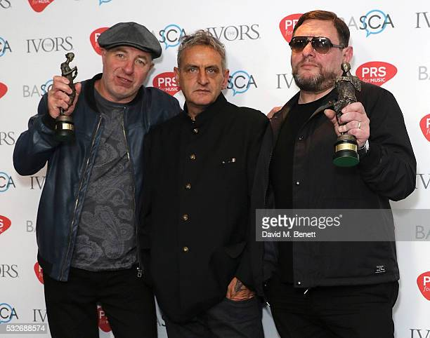 Mark Day Paul Ryder and Shaun Ryder pose for a photo after winning the award for The Ivors Inspiration Award in the winners room during the Ivor...