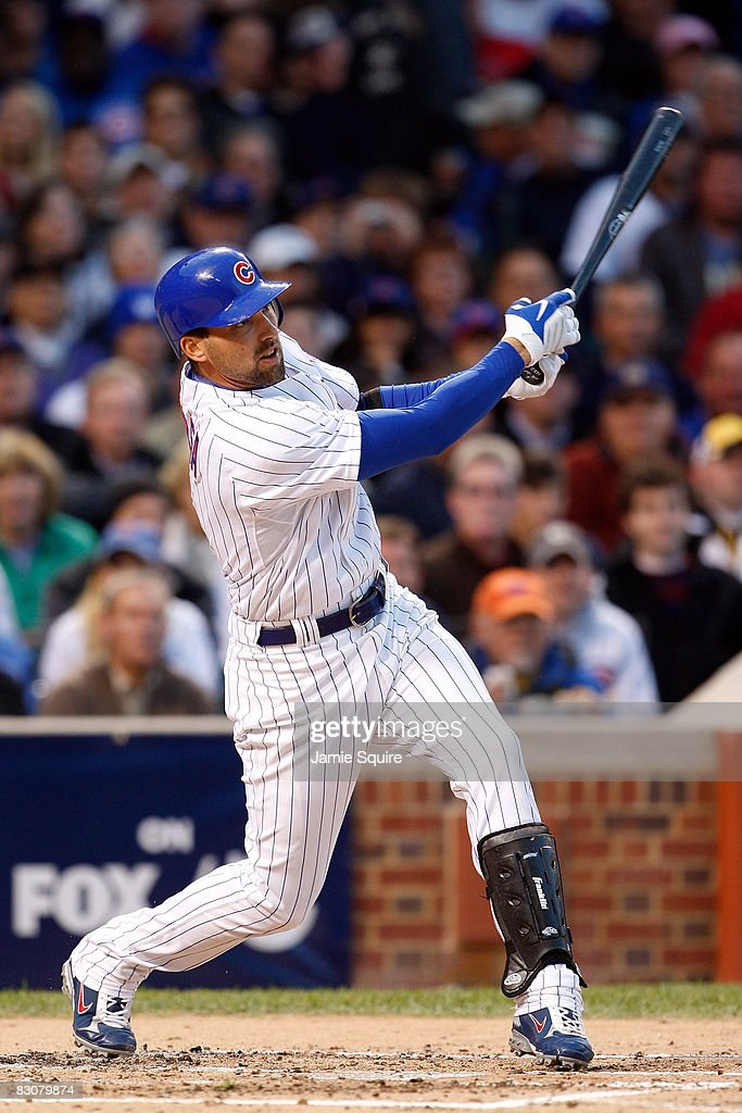 Mark DeRosa #7 of the Chicago Cubs hits a 2-run home run in the bottom of the second inning against the Los Angeles Dodgers in Game One of the NLDS during the 2008 MLB Playoffs at Wrigley Field on October 1, 2008 in Chicago, Illinois.