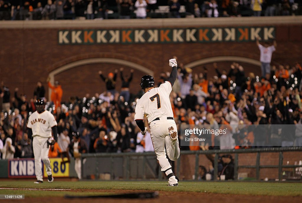 <a gi-track='captionPersonalityLinkClicked' href=/galleries/search?phrase=Mark+DeRosa&family=editorial&specificpeople=228401 ng-click='$event.stopPropagation()'>Mark DeRosa</a> #7 of the San Francisco Giants runs to first base after hitting the game winning hit in the bottom of the 12th inning against the San Diego Padres at AT&T Park on September 13, 2011 in San Francisco, California.