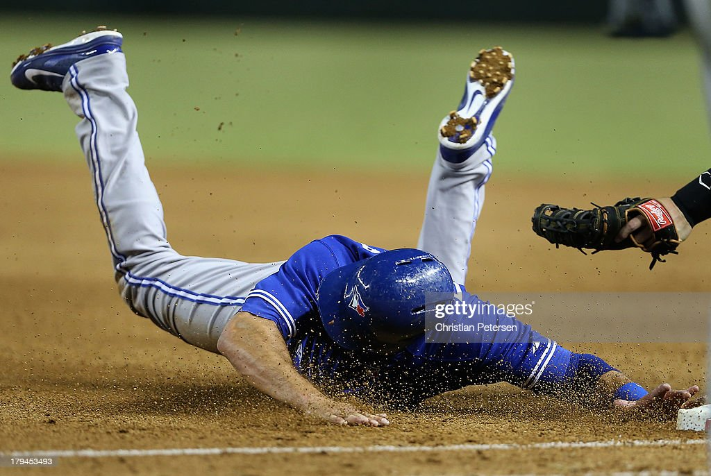 <a gi-track='captionPersonalityLinkClicked' href=/galleries/search?phrase=Mark+DeRosa&family=editorial&specificpeople=228401 ng-click='$event.stopPropagation()'>Mark DeRosa</a> #16 of the Toronto Blue Jays slides back into first base to avoid being thrown out during the fifth inning of the interleague MLB game against the Arizona Diamondbacks at Chase Field on September 3, 2013 in Phoenix, Arizona.