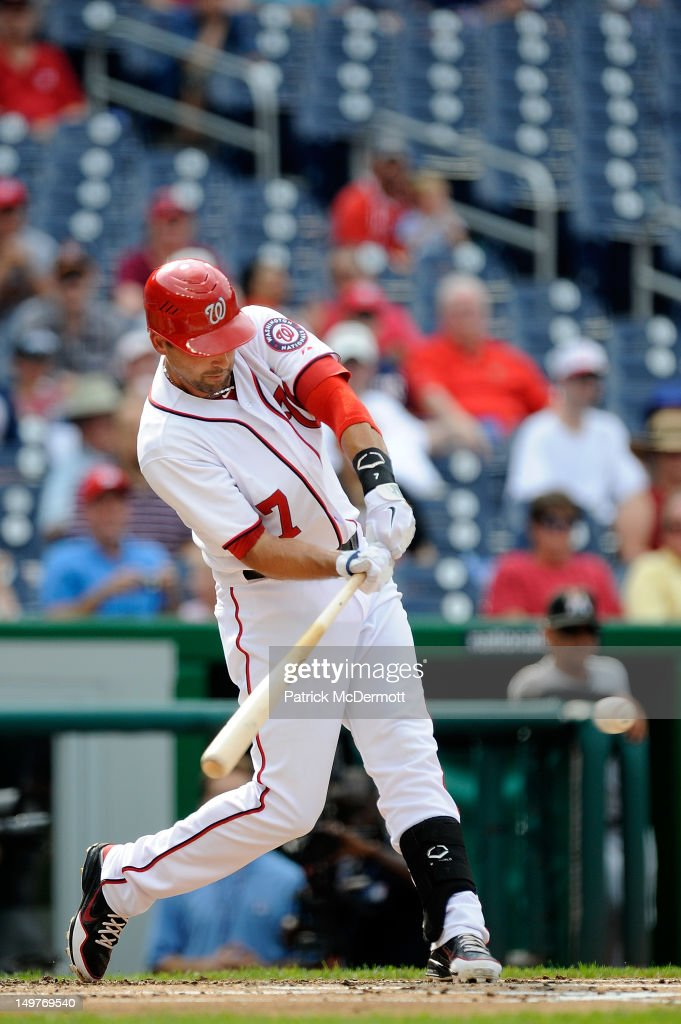 <a gi-track='captionPersonalityLinkClicked' href=/galleries/search?phrase=Mark+DeRosa&family=editorial&specificpeople=228401 ng-click='$event.stopPropagation()'>Mark DeRosa</a> #7 of the Washington Nationals hits a two run RBI single in the first inning against the Miami Marlins at Nationals Park on August 3, 2012 in Washington, DC.