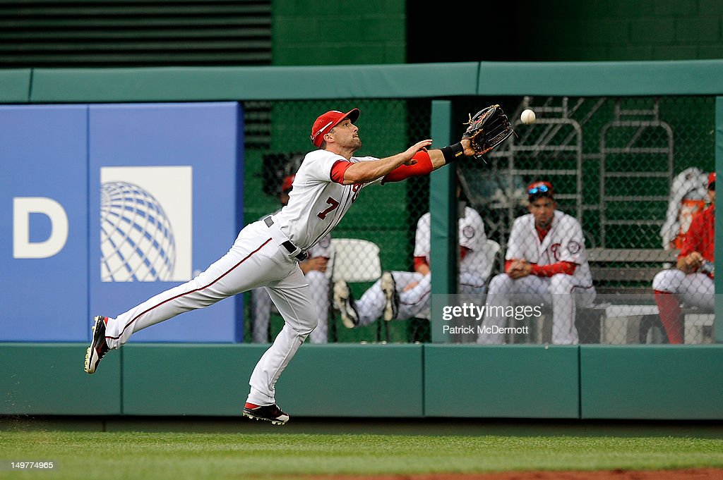 <a gi-track='captionPersonalityLinkClicked' href=/galleries/search?phrase=Mark+DeRosa&family=editorial&specificpeople=228401 ng-click='$event.stopPropagation()'>Mark DeRosa</a> #7 of the Washington Nationals makes an attempt for the ball on a double by Donnie Murphy (not pictured) of the Miami Marlins in the seventh inning at Nationals Park on August 3, 2012 in Washington, DC.