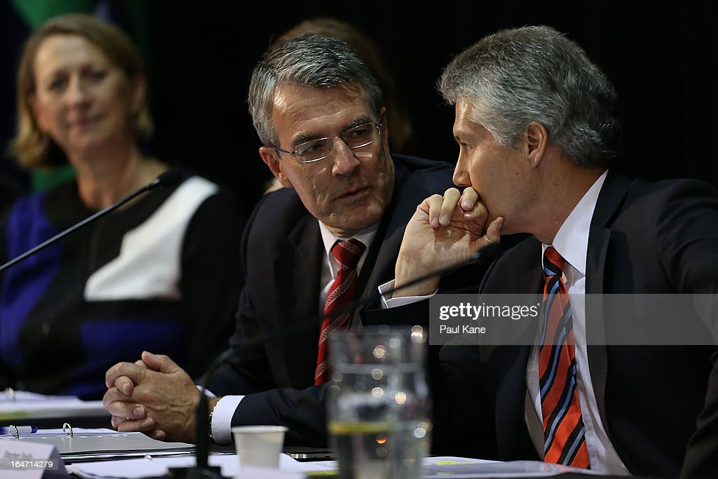Mark Dreyfus, Attorney-General talks with Stephen Smith, Australian Minister for Defence at Thornlie Senior High School on March 27, 2013 in Perth, Australia. Gillard held a community cabinet meeting with members of her new front bench in the suburb of Thornlie today, in her first visit to WA since the Labor party lost state elections.