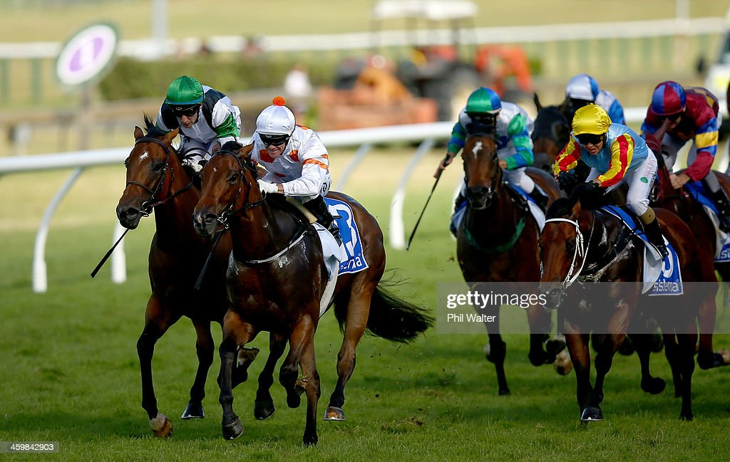 Mark Du Plessis riding Bounding wins the Sistema Railway Stakes during the New Years Day racing at Ellerslie Racecourse on January 1 2014 in Auckland...