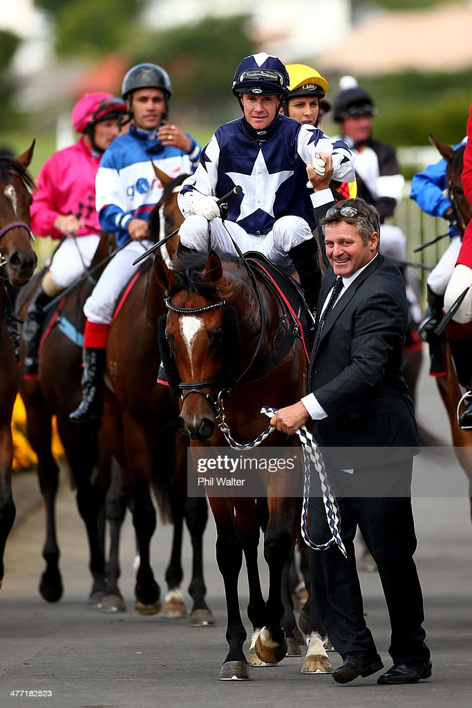 Mark Du Plessis riding Vespa is congratulated by owner Chris Rutten after winning the Diamond Stakes during Diamond Day at the Ellerslie Racecourse...