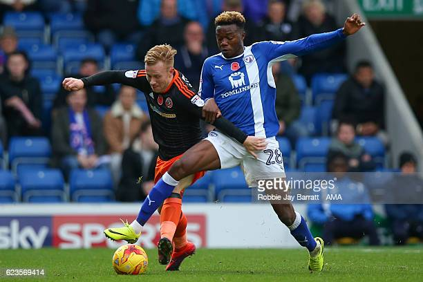 Mark Duffy of Sheffield United and Gboly Ariyibi of Chesterfield during the Sky Bet League One match between Chesterfield and Sheffield United at...