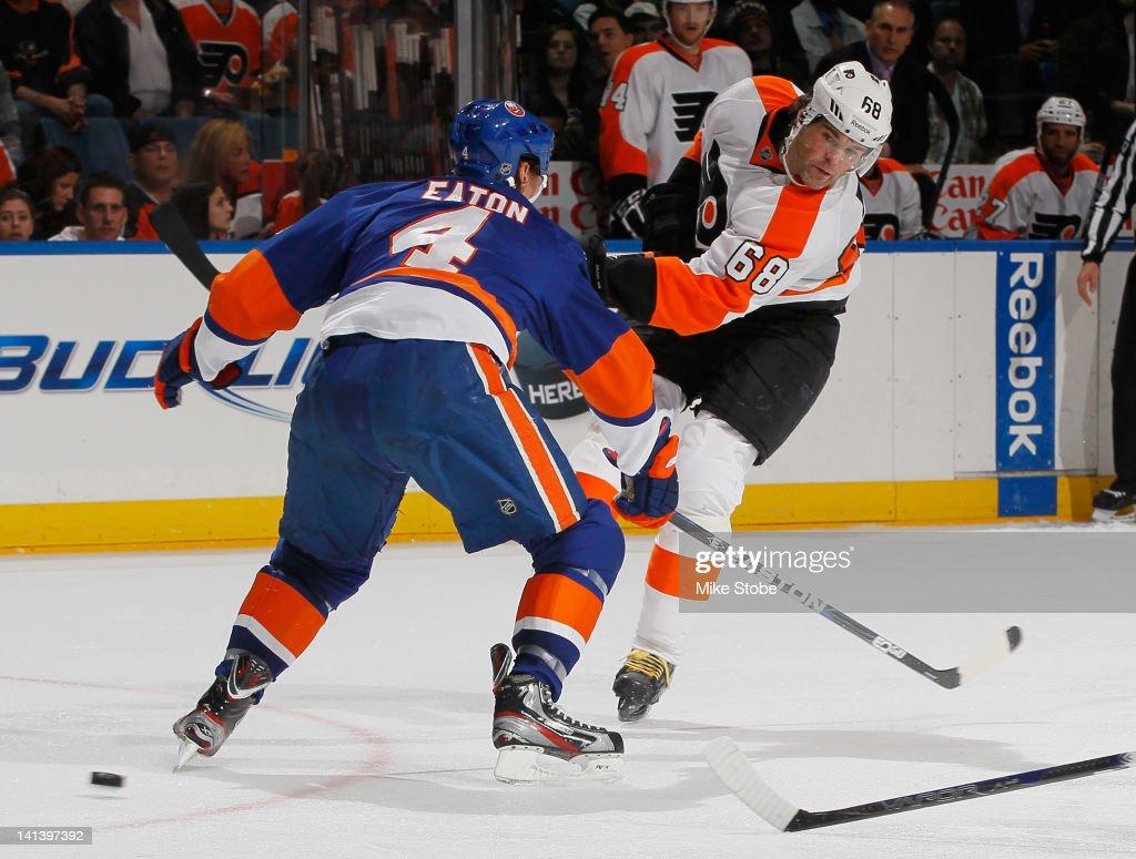 Mark Eaton #4 of the New York Islanders defends against Jaromir Jagr #68 of the Philadelphia Flyers at Nassau Veterans Memorial Coliseum on March 15, 2012 in Uniondale, New York.