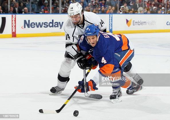 Mark Eaton of the New York Islanders defends against Justin Williams of the Los Angeles Kings on February 11 2012 at Nassau Coliseum in Uniondale New...