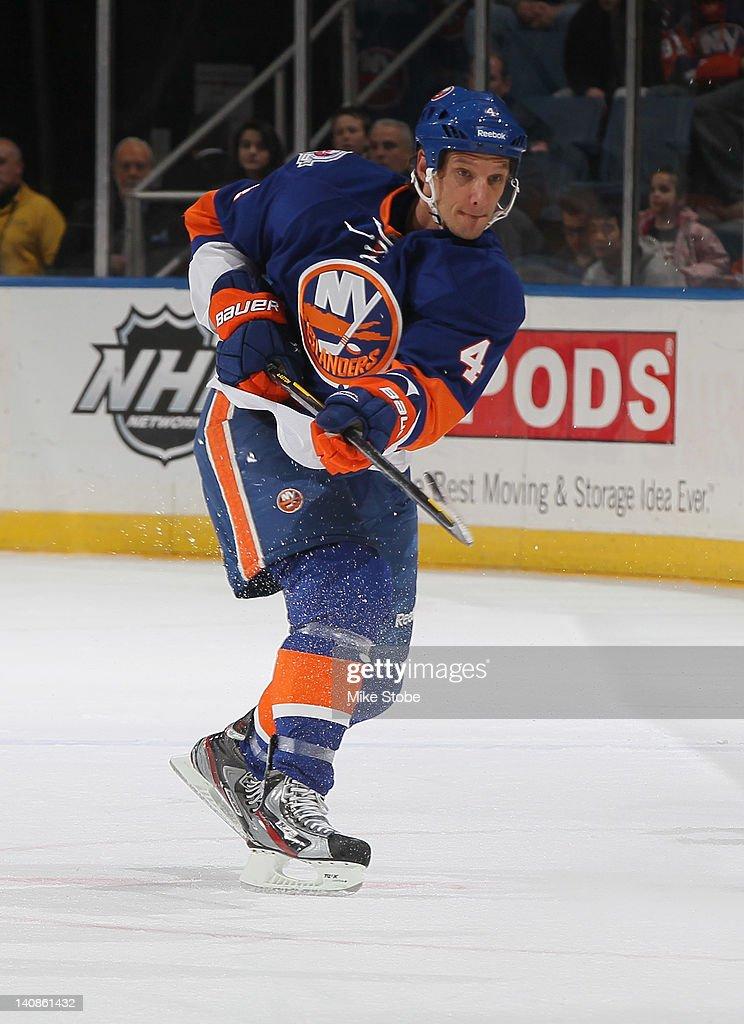 Mark Eaton #4 of the New York Islanders skates against the Carolina Hurricanes at Nassau Veterans Memorial Coliseum on February 18, 2012 in Uniondale, New York. The Islanders defeated the Hurricanes 4-3.