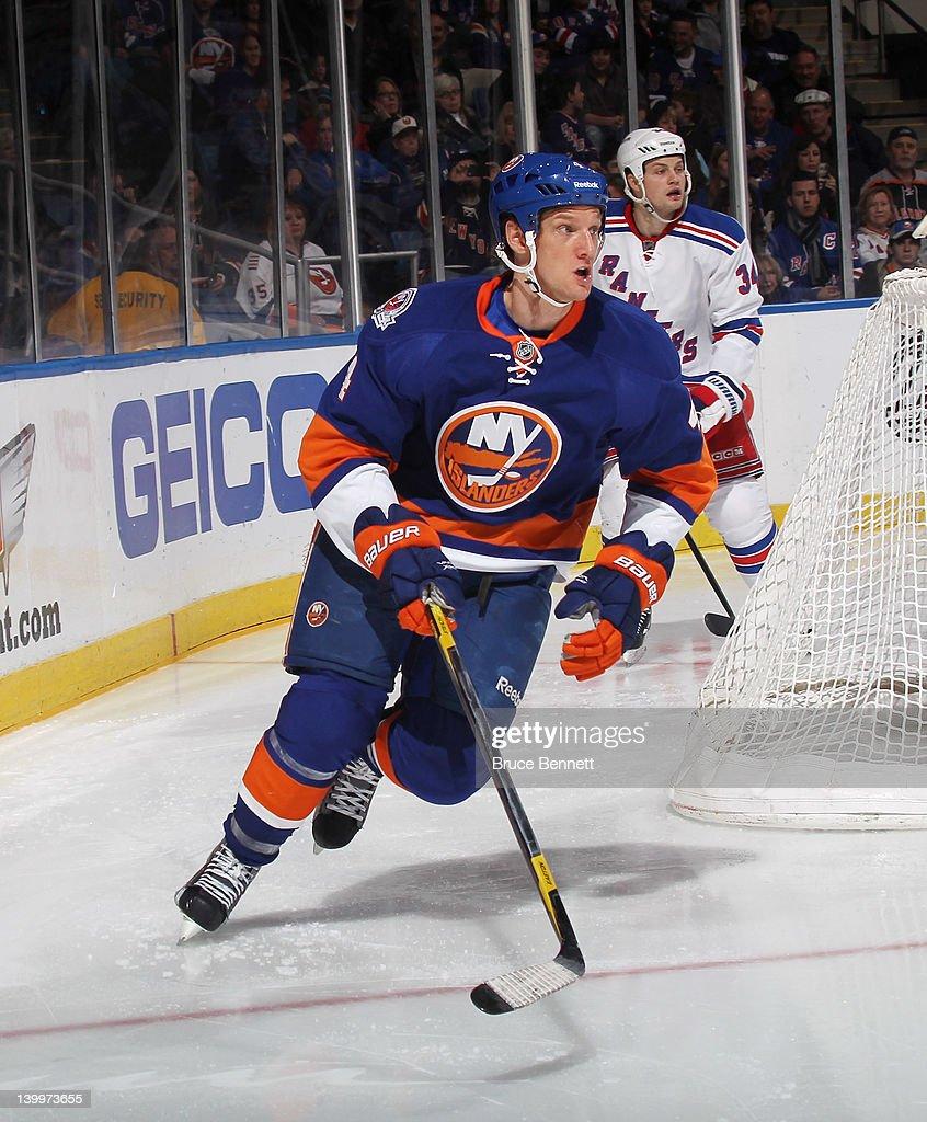 Mark Eaton #4 of the New York Islanders skates against the New York Rangers at the Nassau Veterans Memorial Coliseum on February 24, 2012 in Uniondale, New York. The Islanders defeated the Rangers 4-3 in the shootout.
