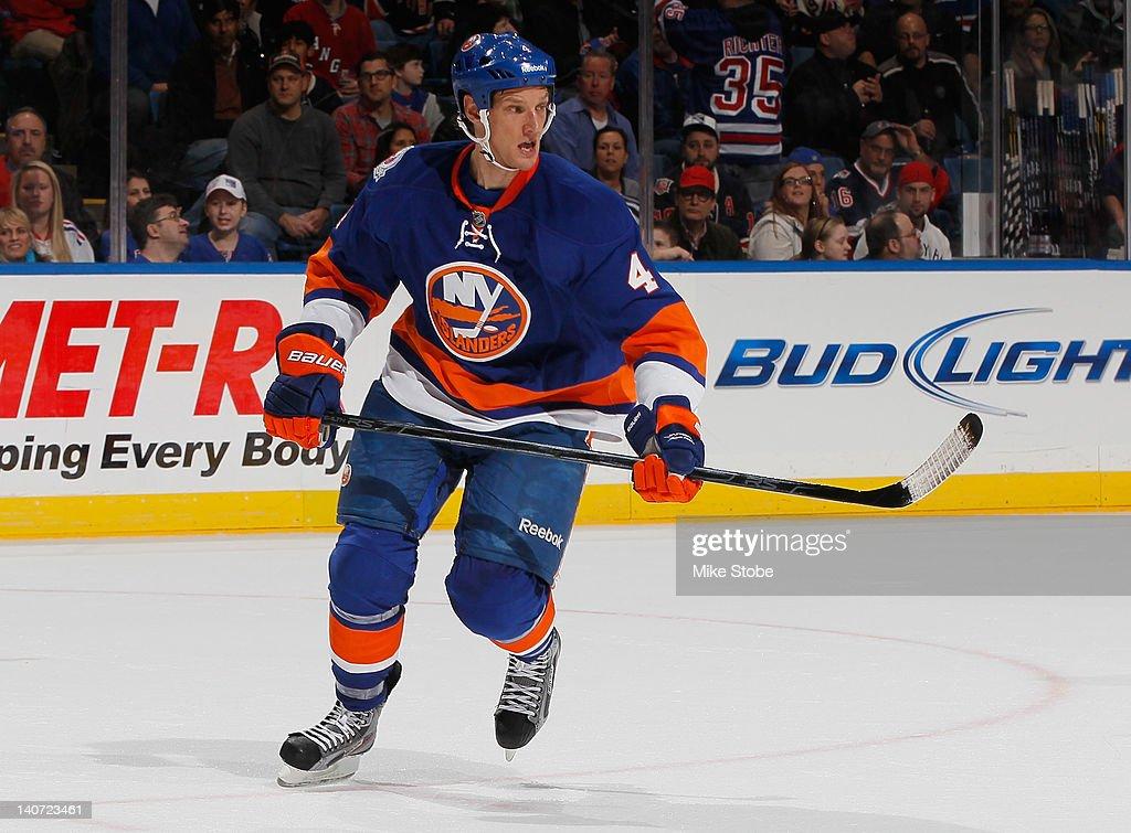 Mark Eaton #4 of the New York Islanders skates against the New York Rangers at Nassau Veterans Memorial Coliseum on February 24, 2012 in Uniondale, New York. The Islanders defeated the Rangers 4-3 in a shootout.