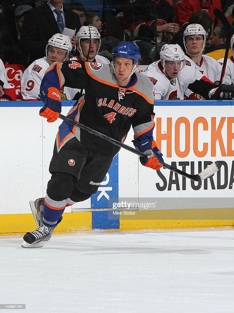 Mark Eaton #4 of the New York Islanders skates against the Ottawa Senators at Nassau Veterans Memorial Coliseum on February 20, 2012 in Uniondale, New York. The Senators defeated the Islanders 6-0.
