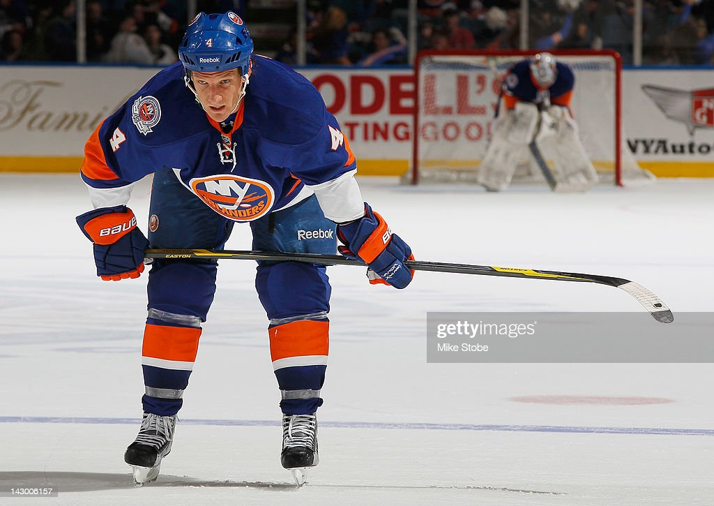 Mark Eaton #4 of the New York Islanders skates against the Ottawa Senators at Nassau Veterans Memorial Coliseum on April 1, 2012 in Uniondale, New York. The Senators defeated the Islanders 5-1.