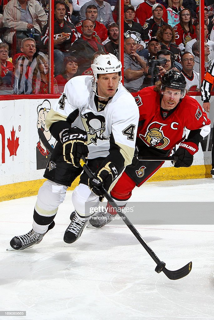 Mark Eaton #4 of the Pittsburgh Penguins controls the puck against <a gi-track='captionPersonalityLinkClicked' href=/galleries/search?phrase=Daniel+Alfredsson&family=editorial&specificpeople=201853 ng-click='$event.stopPropagation()'>Daniel Alfredsson</a> #11 of the Ottawa Senators in Game Three of the Eastern Conference Semifinals during the 2013 NHL Stanley Cup Playoffs at Scotiabank Place on May 19, 2013 in Ottawa, Ontario, Canada.