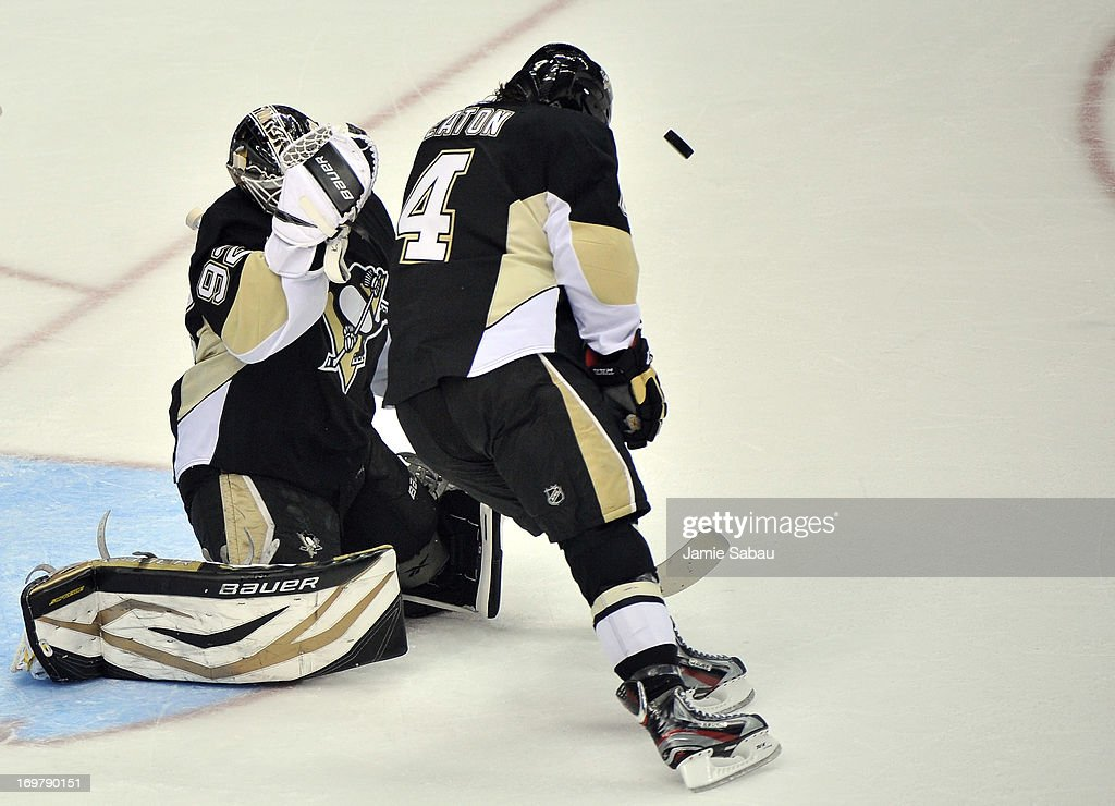 Mark Eaton #4 of the Pittsburgh Penguins is hit in the head with a puck during Game One of the Eastern Conference Final of the 2013 NHL Stanley Cup Playoffs against the Boston Bruins at the Consol Energy Center on June 1, 2013 in Pittsburgh, Pennsylvania.