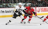 Mark Eaton of the Pittsburgh Penguins keeps the puck away from Daniel Alfredsson the Ottawa Senators during the game at Scotiabank Place on November...
