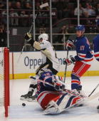 Mark Eaton of the Pittsburgh Penguins scores his first goal of the season in the first period against the New York Rangers on December 3 2008 at...