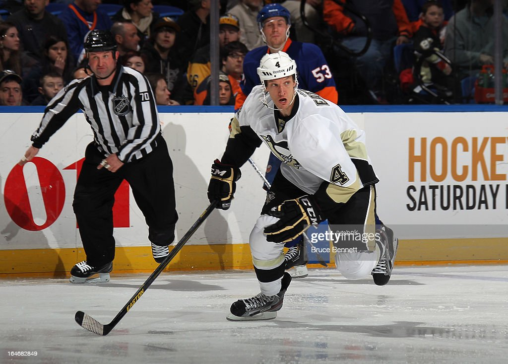 Mark Eaton #4 of the Pittsburgh Penguins skates against the New York Islanders at the Nassau Veterans Memorial Coliseum on March 22, 2013 in Uniondale, New York.