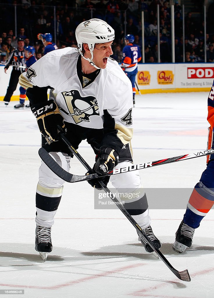 Mark Eaton #4 of the Pittsburgh Penguins skates in an NHL hockey game against the New York Islanders at Nassau Veterans Memorial Coliseum on March 22, 2013 in Uniondale, New York.