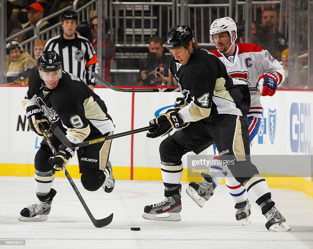 Mark Eaton #4 of the Pittsburgh Penguins watches the loose puck alongside Pascal Dupuis #9 in front of Brian Gionta #21 of the Montreal Canadiens on April17, 2013 at Consol Energy Center in Pittsburgh, Pennsylvania.