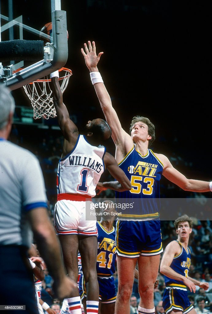 Mark Eaton of the Utah Jazz attempts to block the shot of Gus Williams of the Washington Bullets during an NBA basketball game circa 1985 at the...