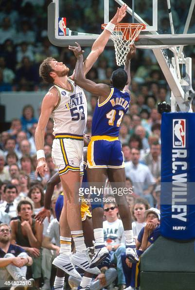 Mark Eaton of the Utah Jazz attempts to block the shot of James Worthy of the Los Angeles Lakers during an NBA basketball game circa 1989 at the Salt...