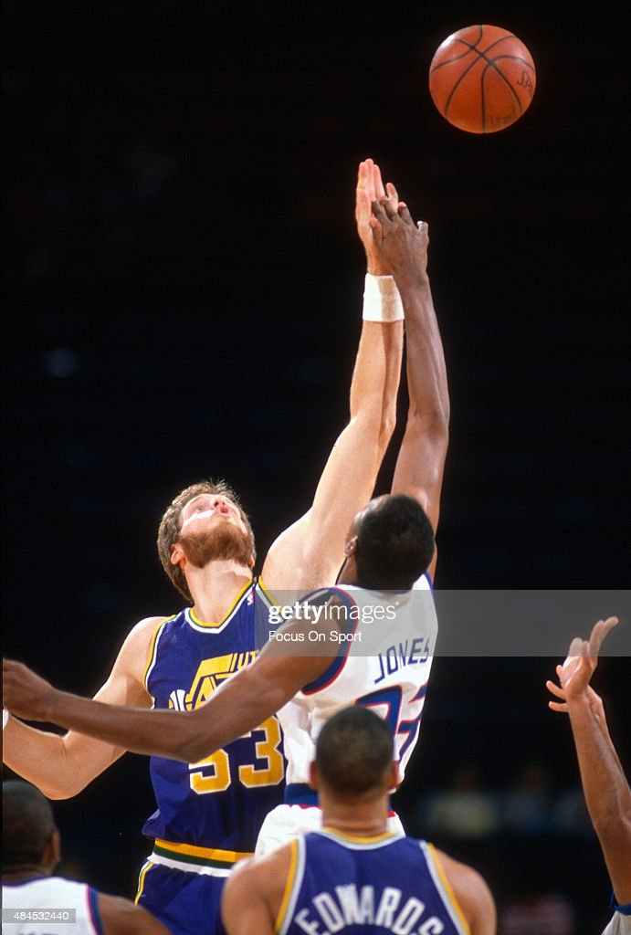 Mark Eaton of the Utah Jazz battles for the tipoff with Charles Jones of the Washington Bullets during an NBA basketball game circa 1989 at the...