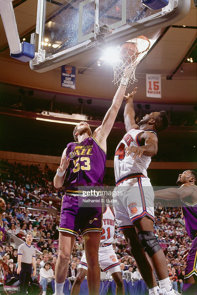 Mark Eaton #53 of the Utah Jazz battles under the basket for a rebound against the New York Knicks during a game at Madison Square Garden Garden circa 1991 in New York City, New York.