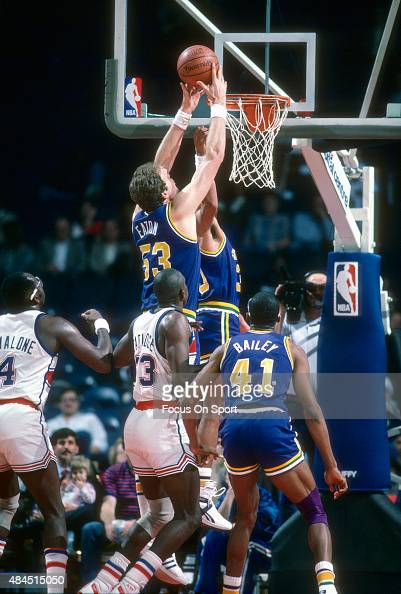 Mark Eaton of the Utah Jazz grabs a rebound against the Washington Bullets during an NBA basketball game circa 1986 at the Capital Centre in Landover...