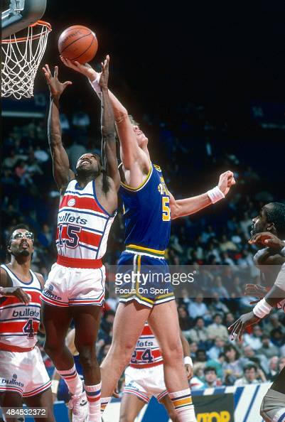 Mark Eaton of the Utah Jazz grabs a rebound over Frank Johnson of the Washington Bullets during an NBA basketball game circa 1986 at the Capital...