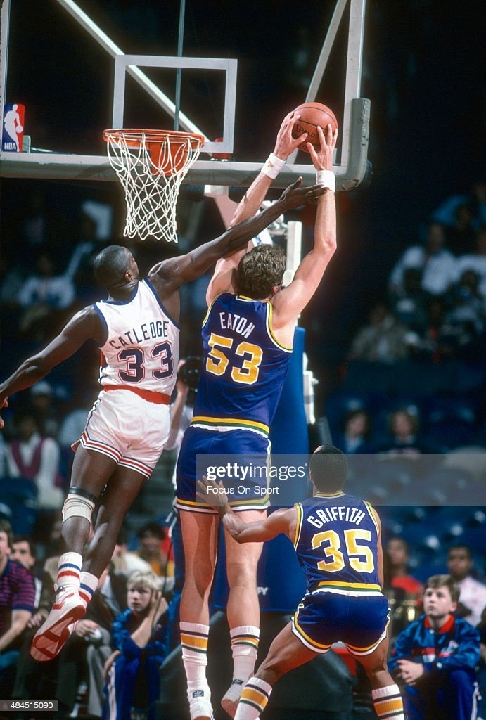 Mark Eaton of the Utah Jazz grabs a rebound over Terry Catledge of the Washington Bullets during an NBA basketball game circa 1986 at the Capital...