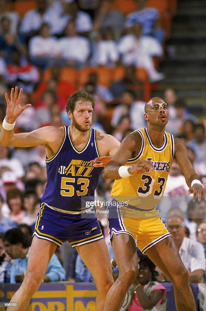 Mark Eaton #53 of the Utah Jazz guards Kareem Abdul-Jabbar #33 of the Los Angeles Lakers during an NBA game at The Salt Palace in Salt Lake City, Utah in 1989.