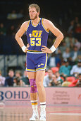 Mark Eaton of the Utah Jazz looks on against the Washington Bullets during an NBA basketball game circa 1989 at the Capital Centre in Landover...