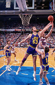 Mark Eaton of the Utah Jazz rebounds against the Sacramento Kings circa 1990 at Arco Arena in Sacramento California NOTE TO USER User expressly...