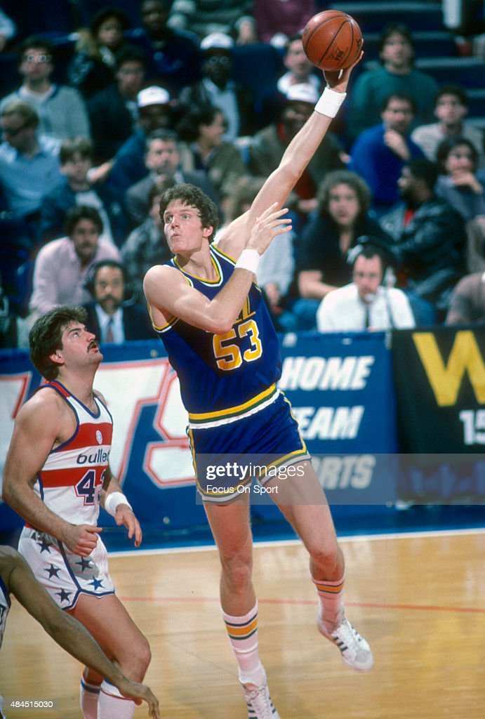 Mark Eaton of the Utah Jazz shoots over Jeff Ruland of the Washington Bullets during an NBA basketball game circa 1984 at the Capital Centre in...